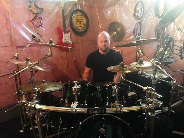 Spencer McLeod Playing His Drum Kit in Calgary