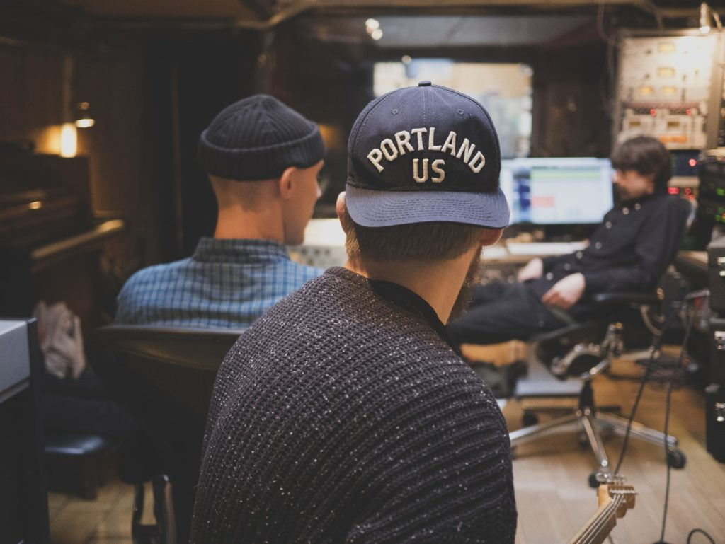 Some guys in a recording studio.