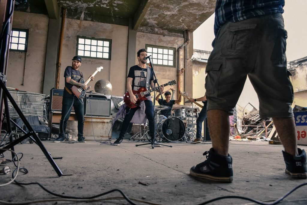a band in a concrete room