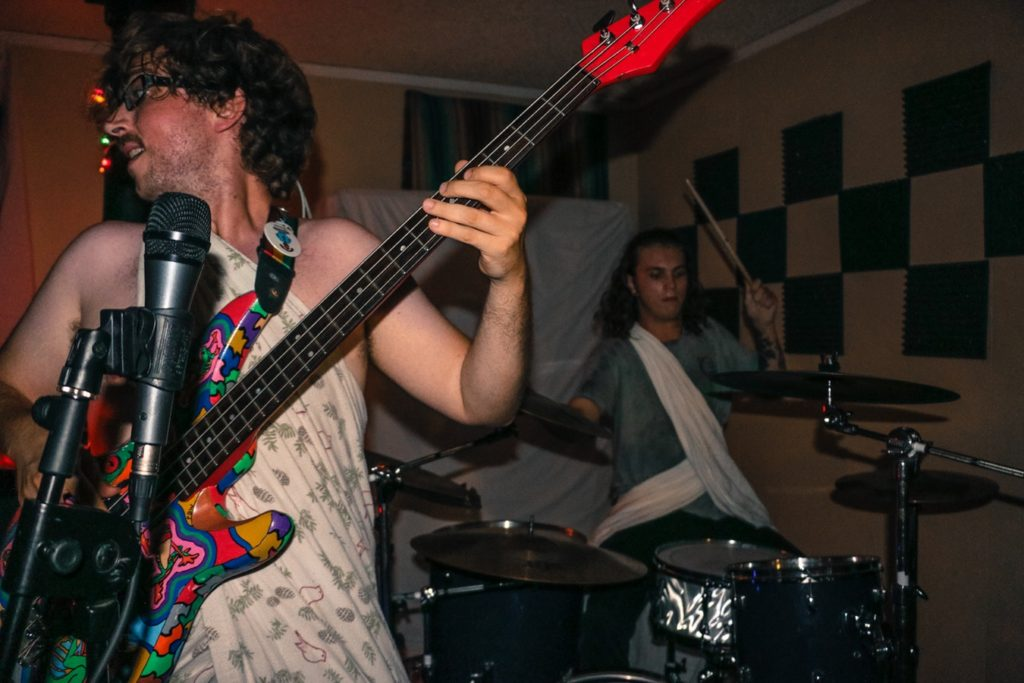 bass player and drummer playing music